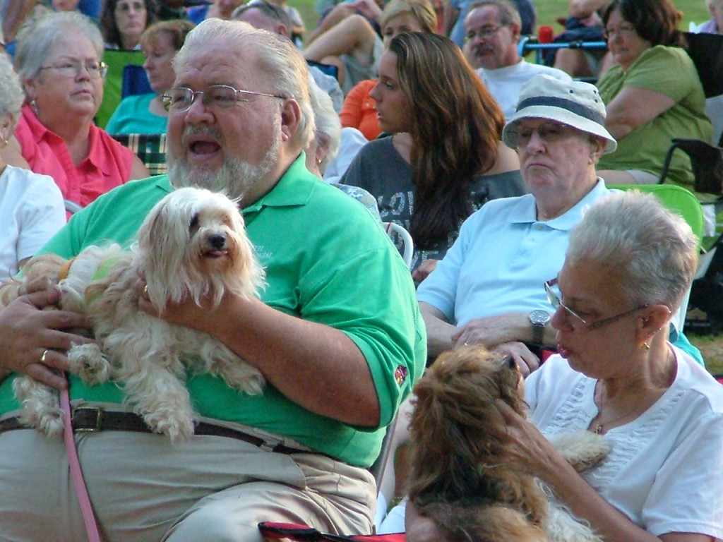 Pastor Ed and Debbie take their Havanese to the outdoor concert.