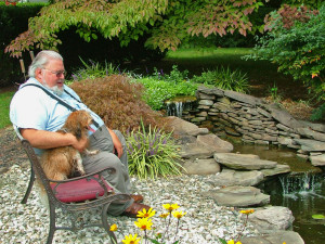 Lokkei relaxes with Pastor Ed at Havs de Grace, Havanese dogs in Havre de Grace, MD