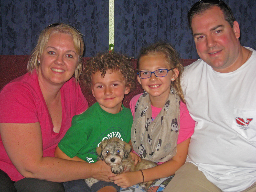 Havanese puppy, Minka, joins her new Forever Family and heads south!